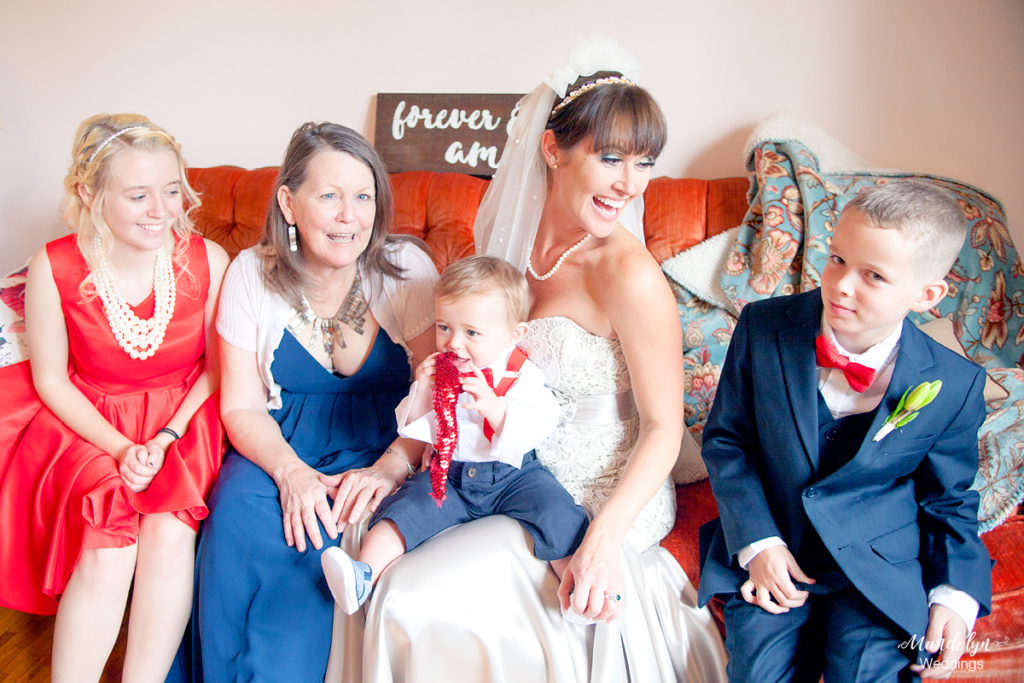 The family of the bride pose for a portrait together on the wedding day.